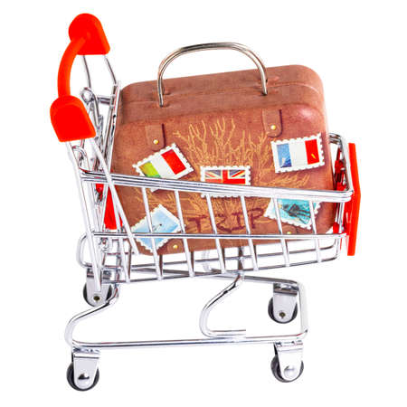 Shopping cart with a suitcase, luggage. Vacation and trave. Фото со стока