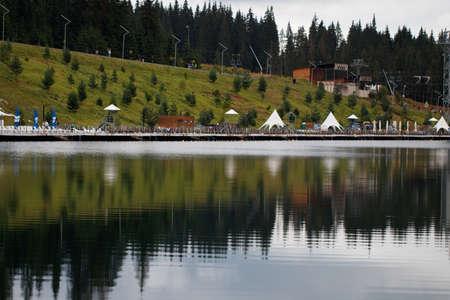 beautiful lake and ski lifts in the mountains. Фото со стока