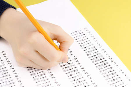 Exam. Filling in the test with a pencil.