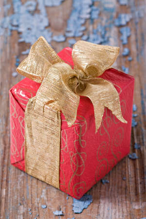 christmas gift box on wooden background photo