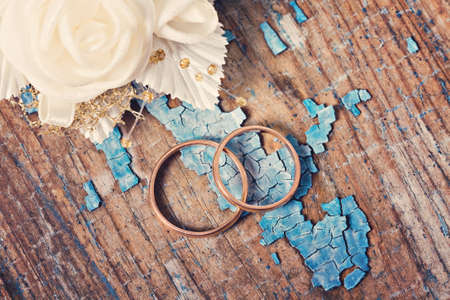wedding accessories: Wedding rings on grunge wooden background Stock Photo