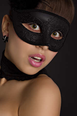Portrait of a young woman wearing black mask photo