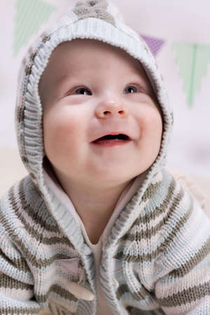 Smiling baby boy in jacket photo