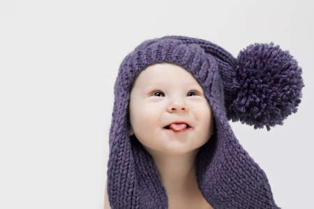 Portrait of baby boy in blue hat Stock Photo - 12930339