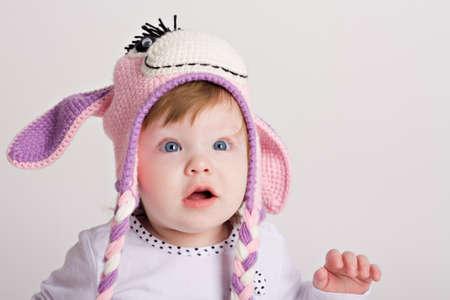Funny girl in hat photo