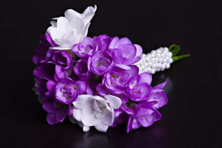 Fresh wedding  bouquet from fresia flowers on dark background photo
