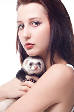 Girl with polecat isolated on white background photo