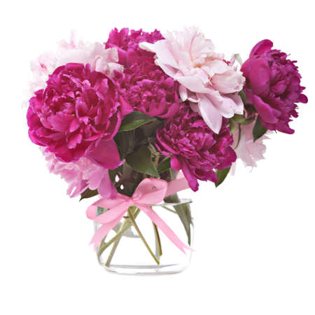Bouquet of peonies blooms in vase isolated on white background photo