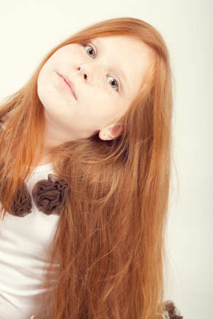 childishness: Portrait of a beautiful redhead girl with long hair