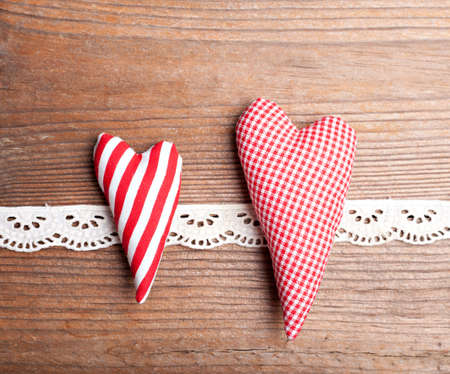 two hearts: Two textile hearts on wooden background Stock Photo