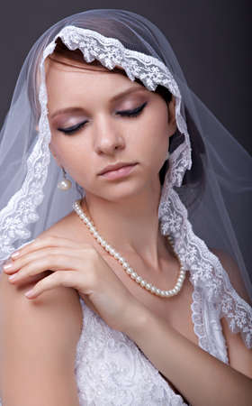 Beautiful bride with veil on head.  photo