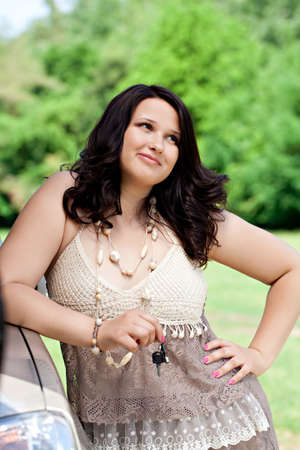 plus size: Beautiful plus size model outdoors near car