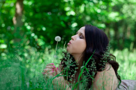 overweight students: Beautiful plus size model outdoors with dandelion Stock Photo