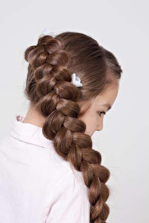 hairdo: hairstyle portrait of beautiful girl with creative braid hairdo