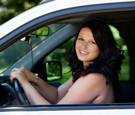 sizes: Beautiful plus size model outdoors in car