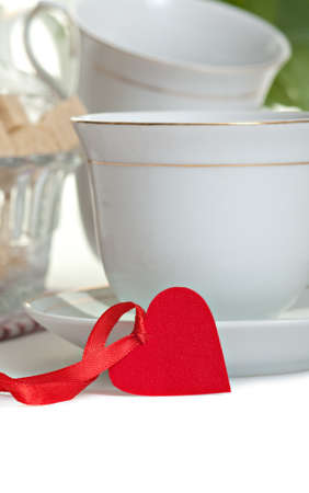 Cup of tea with heart shape on red ribbon(Valentines day or Love concept) photo