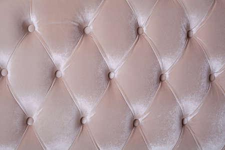 velvet background: golden picture of genuine velvet upholstery