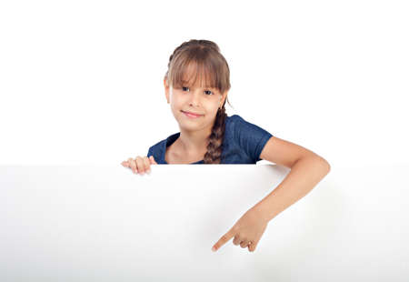 Cute caucasian girl with blank board isolated over white photo