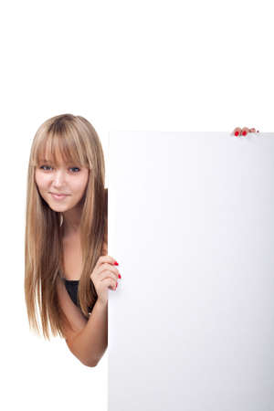 Beautiful girl holding a banner  Isolated over white  photo