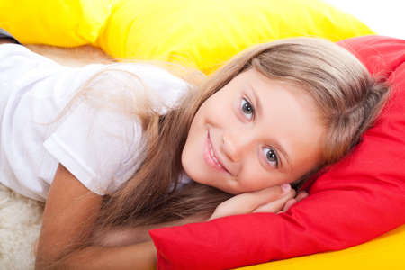 Girl lying on color pillows photo