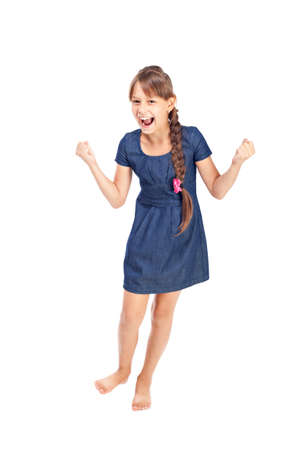 Full length portrait of a happy little girl on white background photo