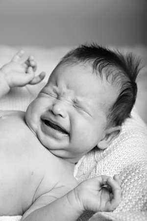 blackwhite: Newborn crying baby. Black-white image