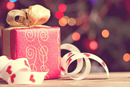 Red giftbox against bokeh background Stock Photo - 15683260