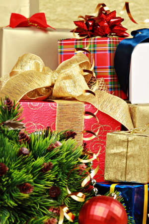 Stack of christmas gift boxes with bow and balls photo