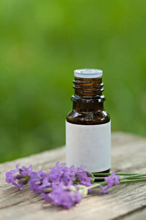 Aromatherapy oil and lavender flowers outdoor