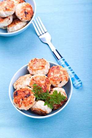 Meatballs in blue bowls on table Stock Photo - 16931023