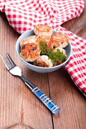 Meatballs in blue bowls on table Stock Photo - 16931024