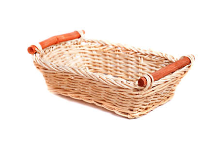 hamper: Empty wicker basket isolated over white