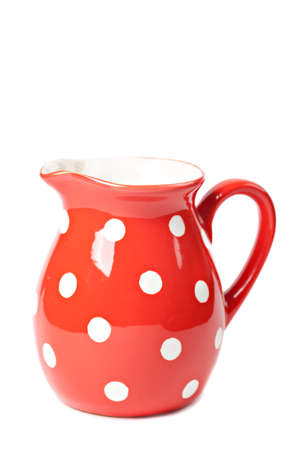 red clay: Retro red pitcher isolated over white