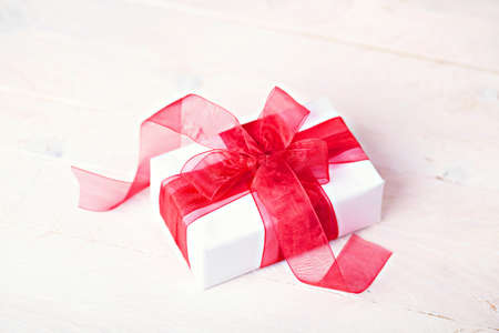 giftbox: Giftbox with red ribbon Stock Photo