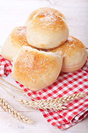 Fresh homemade bread rolls with sesam seed on table Stock Photo - 17710326