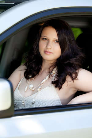 Beautiful plus size model outdoors in car photo
