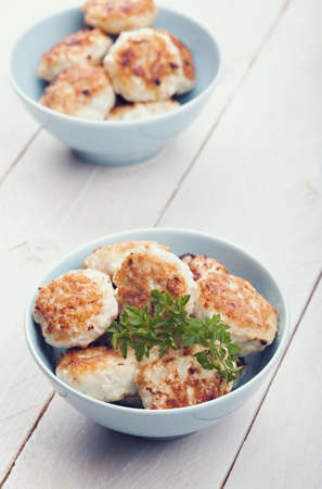 Meatballs in blue bowls on table Stock Photo - 18453335