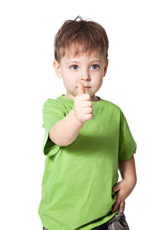 smile boy with finger up isolated over white photo