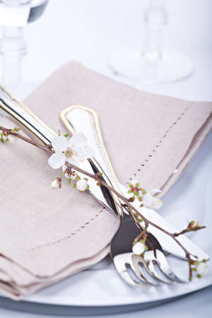 Table setting with blossoming spring flowers photo