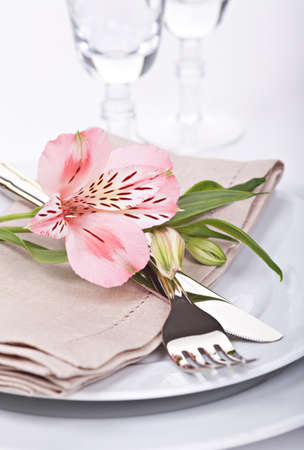 Table setting with pink alstroemeria flowers photo