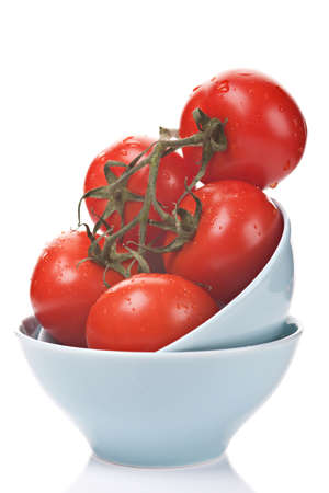 Bunch of ripe tomatoes with water drops on white background photo