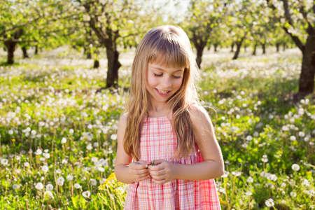 sundress: Cute smile girl in garden with dandelions