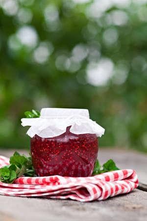 jam jar: Raspberry jam in a jar outdoor