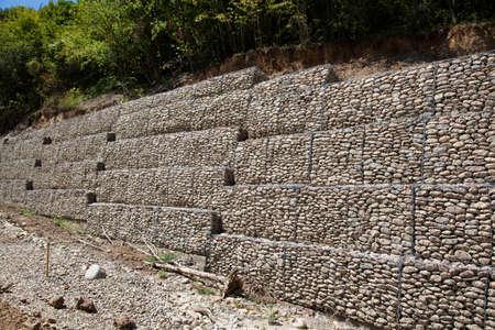 gabion: Protective gabion wall in mountains