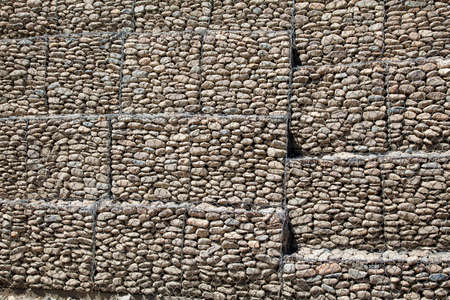 Protective gabion wall in mountains photo