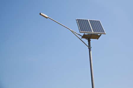 Solar panel and streetlight photo