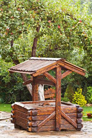 draw well: Wooden well in garden