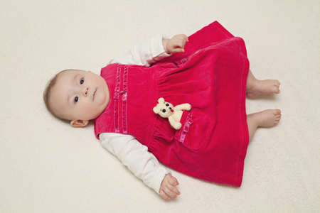 velvet dress: Baby girl in red velvet dress on white