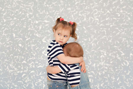boy lady: Sisters love. Protects the childs older sister Stock Photo
