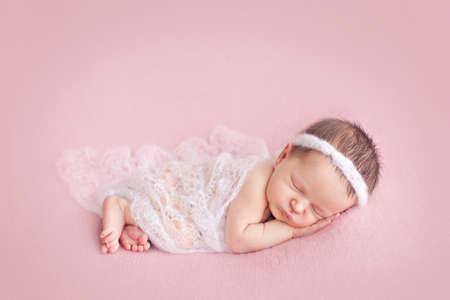 pink posing: Newborn baby girl posing on pink background